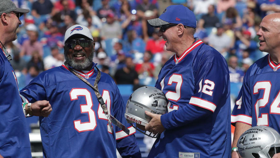 BUFFALO, NY - SEPTEMBER 10: Thurman Thomas #34 of the Buffalo Bills and Jim Kelly #12 at a halftime ceremony honoring the 25th anniversary of the greatest comeback win in NFL history during NFL game action against the New York Jets at New Era Field on September 10, 2017 in Buffalo, New York. (Photo by Tom Szczerbowski/Getty Images)