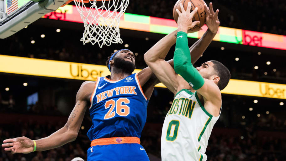 BOSTON, MA - NOVEMBER 21: Jayson Tatum #0 of the Boston Celtics goes to the basket against Mitchell Robinson #26 of the New York Knicks during a game at TD Garden on November 21, 2018 in Boston, Massachusetts.  NOTE TO USER: User expressly acknowledges and agrees that, by downloading and or using this photograph, User is consenting to the terms and conditions of the Getty Images License Agreement. (Photo by Kathryn Riley/Getty Images)