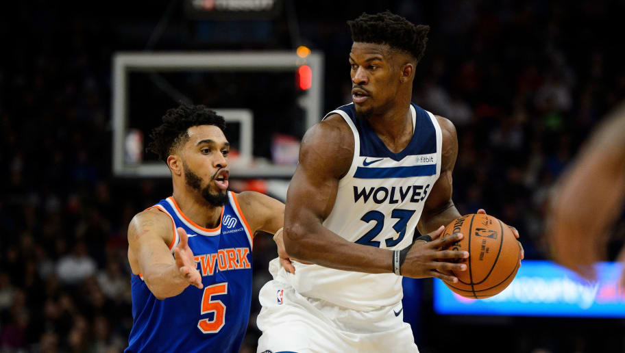 MINNEAPOLIS, MN - JANUARY 12: Jimmy Butler #23 of the Minnesota Timberwolves has the ball against Courtney Lee #5 of the New York Knicks during the game on January 12, 2018 at the Target Center in Minneapolis, Minnesota. NOTE TO USER: User expressly acknowledges and agrees that, by downloading and or using this Photograph, user is consenting to the terms and conditions of the Getty Images License Agreement. (Photo by Hannah Foslien/Getty Images)
