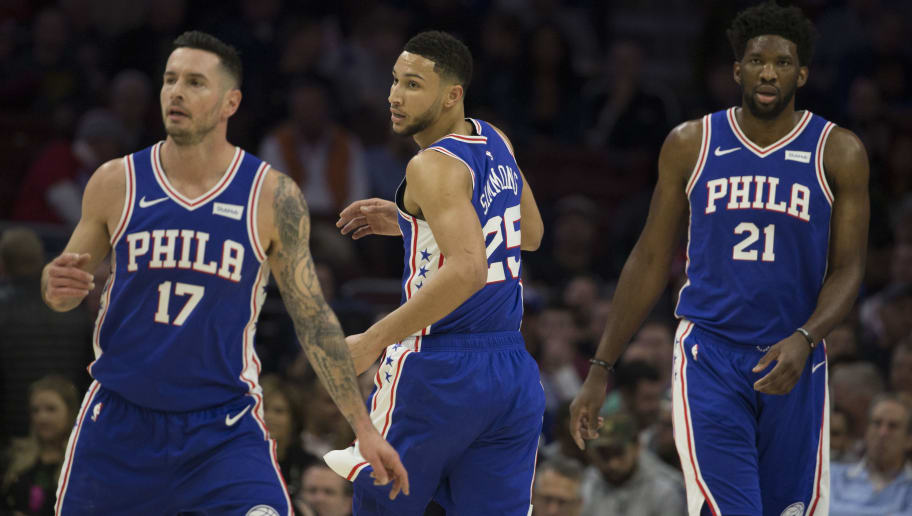 PHILADELPHIA, PA - NOVEMBER 28: JJ Redick #17, Ben Simmons #25, and Joel Embiid #21 of the Philadelphia 76ers in action in the first quarter against the New York Knicks at the Wells Fargo Center on November 28, 2018 in Philadelphia, Pennsylvania. The 76ers defeated the Knicks 117-91. NOTE TO USER: User expressly acknowledges and agrees that, by downloading and or using this photograph, User is consenting to the terms and conditions of the Getty Images License Agreement. (Photo by Mitchell Leff/Getty Images)