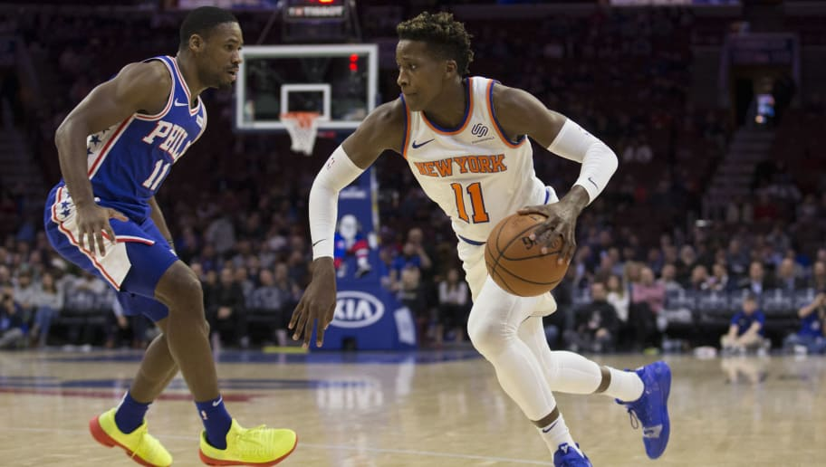 PHILADELPHIA, PA - NOVEMBER 28: Frank Ntilikina #11 of the New York Knicks dribbles the ball against Demetrius Jackson #11 of the Philadelphia 76ers at the Wells Fargo Center on November 28, 2018 in Philadelphia, Pennsylvania. NOTE TO USER: User expressly acknowledges and agrees that, by downloading and or using this photograph, User is consenting to the terms and conditions of the Getty Images License Agreement. (Photo by Mitchell Leff/Getty Images)