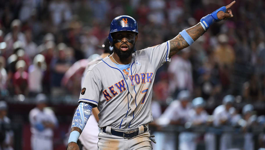 PHOENIX, AZ - JUNE 17:  Jose Reyes #7 of the New York Mets gestures to the sky after scoring on a double by Jose Bautista #11 during the ninth inning against the Arizona Diamondbacks at Chase Field on June 17, 2018 in Phoenix, Arizona.  (Photo by Norm Hall/Getty Images)