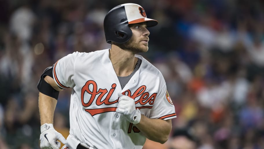 BALTIMORE, MD - AUGUST 14: Chris Davis #19 of the Baltimore Orioles hits a home run against the New York Mets during the seventh inning at Oriole Park at Camden Yards on August 14, 2018 in Baltimore, Maryland. (Photo by Scott Taetsch/Getty Images)