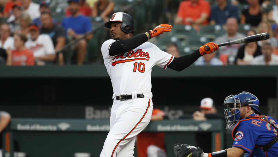 BALTIMORE, MD - AUGUST 15: Adam Jones #10 of the Baltimore Orioles hits an RBI single scoring Jonathan Villar #34 (not pictured) in the first inning against the New York Mets at Oriole Park at Camden Yards on August 15, 2018 in Baltimore, Maryland. (Photo by Patrick McDermott/Getty Images)