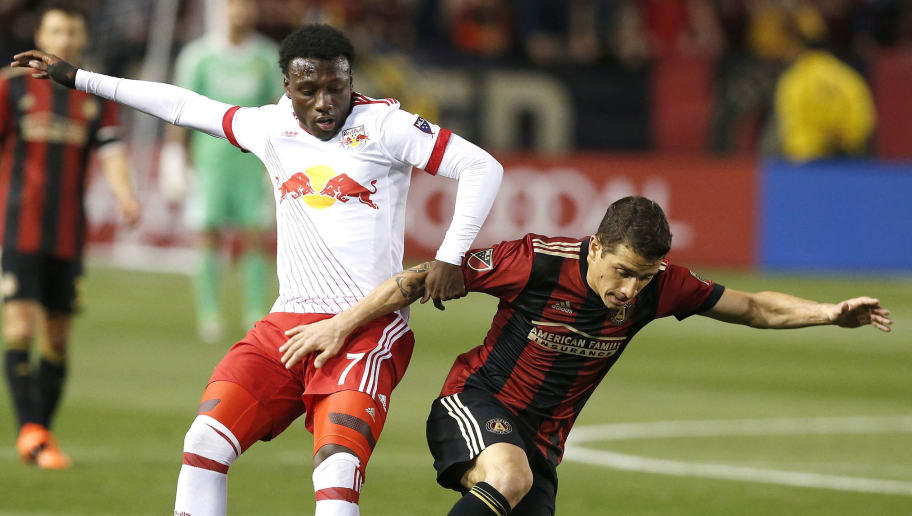 ATLANTA, GA - MARCH 05:  Midfielder Derrick Etienne, Jr. #7 of the New York Red Bulls battles for the ball with midfielder Carlos Carmona #14 of Atlanta United during the game at Bobby Dodd Stadium on March 5, 2017 in Atlanta, Georgia.  (Photo by Mike Zarrilli/Getty Images)