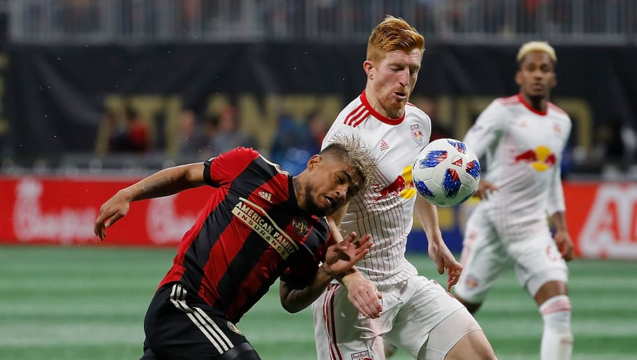 ATLANTA, GA - NOVEMBER 25:  Josef Martinez #7 of Atlanta United attempts a header against Tim Parker #26 of New York Red Bulls during the MLS Eastern Conference Finals between Atlanta United and the New York Red Bulls at Mercedes-Benz Stadium on November 25, 2018 in Atlanta, Georgia.  (Photo by Kevin C. Cox/Getty Images)