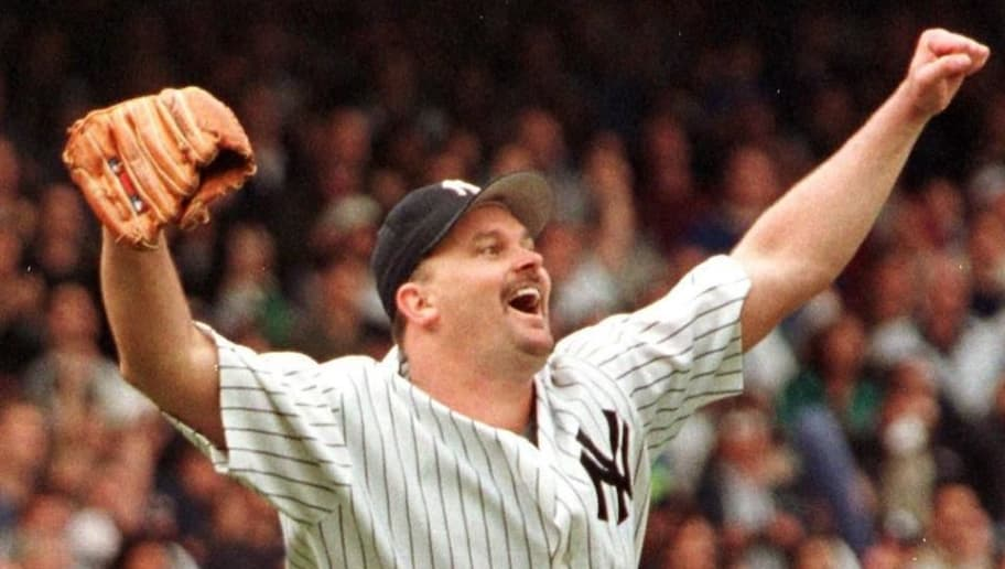 NEW YORK, UNITED STATES:  New York Yankees pitcher David Wells reacts as the final out is recorded completing his perfect game against the Minnesota Twins 17 May at Yankee Stadium in New York City.  Don Larsen pitched the only other perfect game in Yankees history in the 1956 World Series.  The Yankees beat the Twins 4-0.  AFP PHOTO/Matt CAMPBELL (Photo credit should read MATT CAMPBELL/AFP/Getty Images)