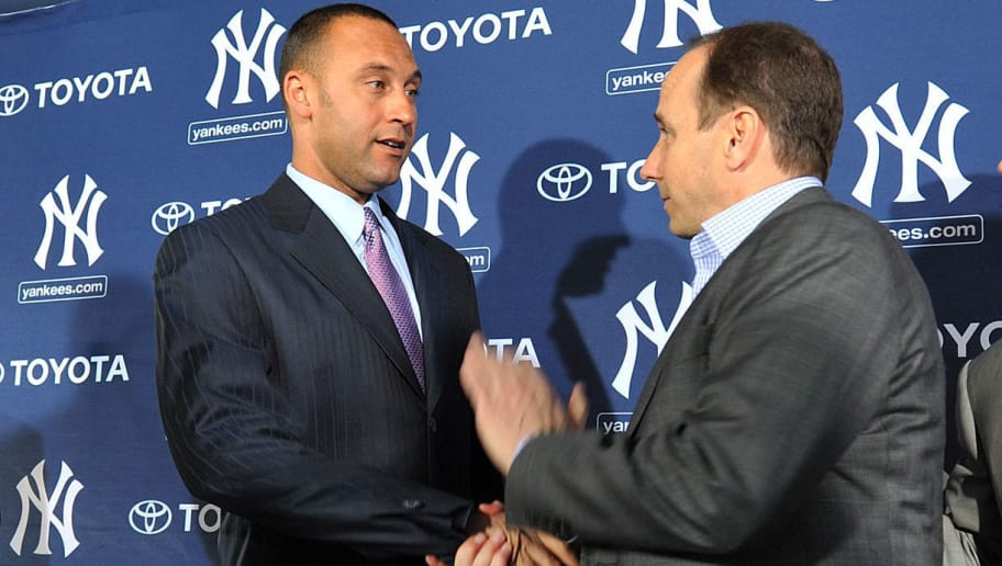 Derek Jeter and Brian Cashman Clearly Had Testy Relationship Before  Giancarlo Stanton Trade a7bb2b1ad89f