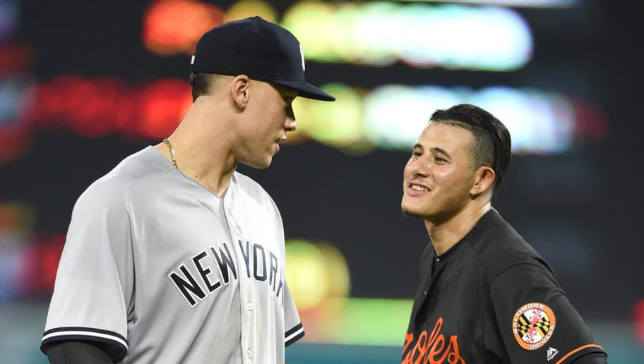 BALTIMORE, MD - JUNE 01:  Aaron Judge #99 of the New York Yankees and Manny Machado #13 of the Baltimore Orioles talk between inning pitches during a baseball game at Oriole Park at Camden Yards on June 1, 2018 in Baltimore, Maryland.  (Photo by Mitchell Layton/Getty Images)