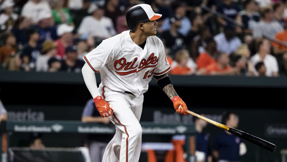 BALTIMORE, MD - JULY 11: Manny Machado #13 of the Baltimore Orioles doubles against the New York Yankees during the sixth inning at Oriole Park at Camden Yards on July 11, 2018 in Baltimore, Maryland. (Photo by Scott Taetsch/Getty Images)