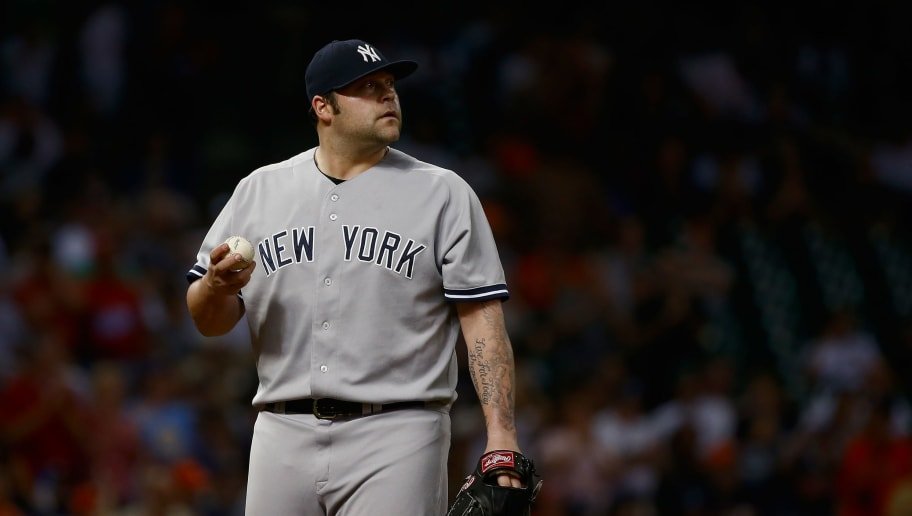 HOUSTON, TX - SEPTEMBER 27:  Joba Chamberlain #62 of the New York Yankees reacts to allowing a two run double in the seventh inning against the Houston Astros at Minute Maid Park on September 27, 2013 in Houston, Texas.  (Photo by Scott Halleran/Getty Images)