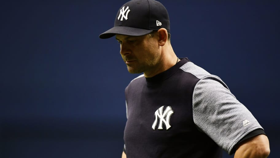 ST PETERSBURG, FL - SEPTEMBER 27: Aaron Boone #17 of the New York Yankees reacts after CC Sabathia #52 hit Jesus Sucre #45 of the Tampa Bay Rays by a pitch in the sixth inning on September 27, 2018 at Tropicana Field in St Petersburg, Florida. (Photo by Julio Aguilar/Getty Images)