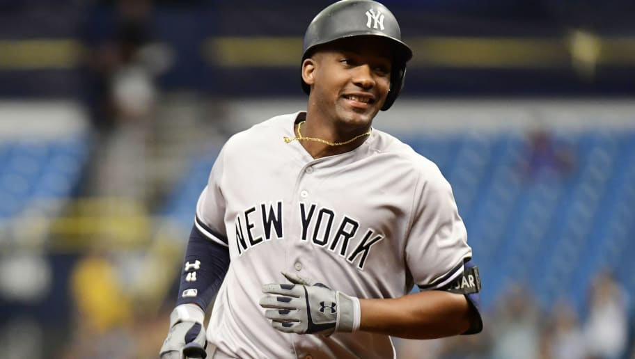 ST PETERSBURG, FL - SEPTEMBER 27: Miguel Andujar #41 of the New York Yankees hits a three-run homer in the first inning against the Tampa Bay Rays on September 27, 2018 at Tropicana Field in St Petersburg, Florida. (Photo by Julio Aguilar/Getty Images)
