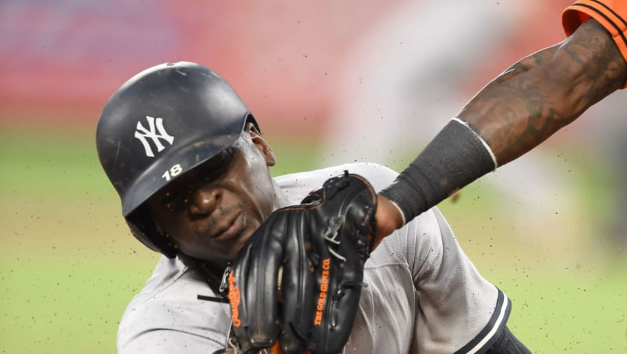 BALTIMORE, MD - JULY 09:  Didi Gregorius #18 of the New York Yankees is caught stealing in the third inning by Manny Machado #13 of the Baltimore Orioles during a game two of a doubleheader baseball game at Oriole Park at Camden Yards on July 9, 2018 in Baltimore, Maryland.  (Photo by Mitchell Layton/Getty Images)
