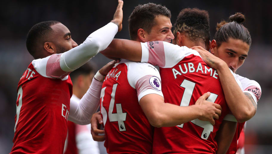 NEWCASTLE UPON TYNE, ENGLAND - SEPTEMBER 15:  Granit Xhaka of Arsenal celebrates after scoring a goal to make it 0-1 during the Premier League match between Newcastle United and Arsenal FC at St. James Park on September 15, 2018 in Newcastle upon Tyne, United Kingdom. (Photo by Robbie Jay Barratt - AMA/Getty Images)