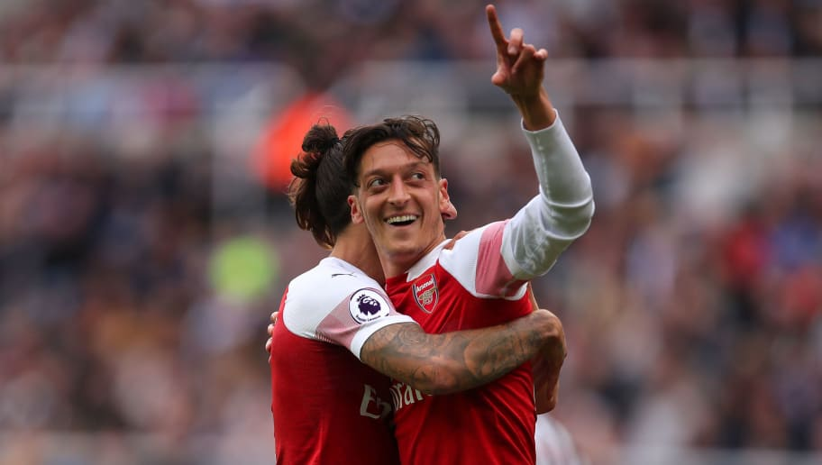 NEWCASTLE UPON TYNE, ENGLAND - SEPTEMBER 15:  Mesut Ozil of Arsenal celebrates after scoring a goal to make it 0-2 during the Premier League match between Newcastle United and Arsenal FC at St. James Park on September 15, 2018 in Newcastle upon Tyne, United Kingdom. (Photo by Robbie Jay Barratt - AMA/Getty Images)