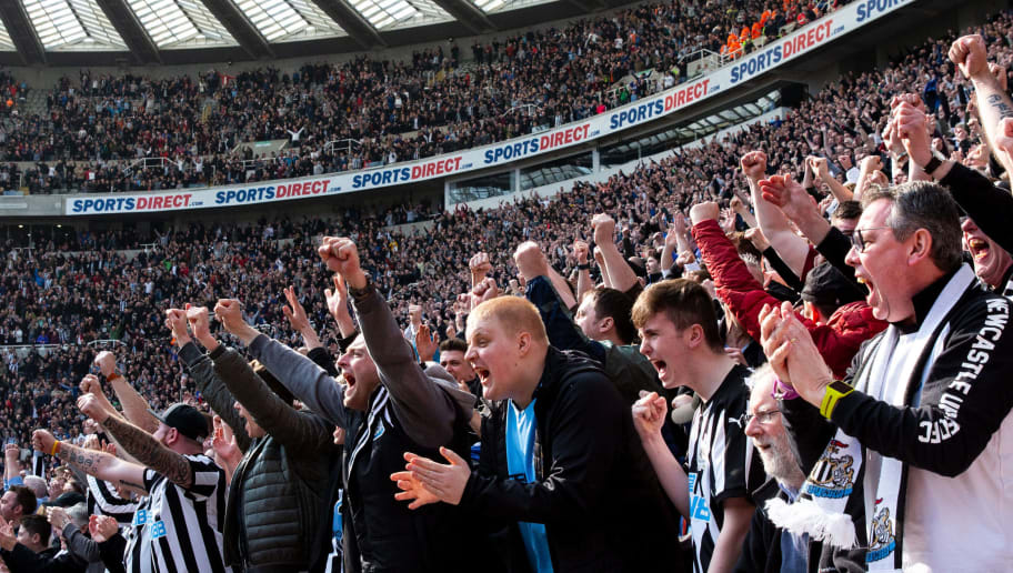 NEWCASTLE UPON TYNE, ENGLAND - APRIL 15: Fans of Newcastle United celebrate at full time during the Premier League match between Newcastle United and Arsenal at St. James Park on April 15, 2018 in Newcastle upon Tyne, England. (Photo by Robbie Jay Barratt - AMA/Getty Images)