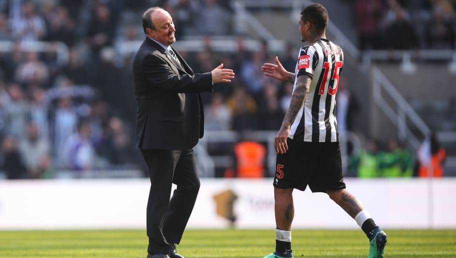 NEWCASTLE UPON TYNE, ENGLAND - APRIL 15: Rafa Benitez head coach / manager  of Newcastle United and Kenedy of Newcastle United celebrate at full time during the Premier League match between Newcastle United and Arsenal at St. James Park on April 15, 2018 in Newcastle upon Tyne, England. (Photo by Robbie Jay Barratt - AMA/Getty Images)