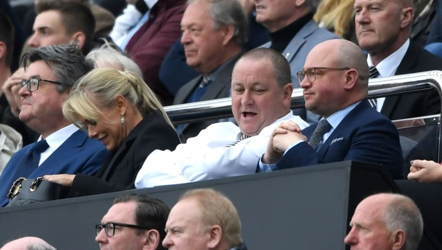 NEWCASTLE UPON TYNE, ENGLAND - MAY 07: Mike Ashley, owner of Newcastle United and Lee Charnley, managing director of Newcastle United both look on from the stands during the Sky Bet Championship match between Newcastle United and Barnsley at St James' Park on May 7, 2017 in Newcastle upon Tyne, England.  (Photo by Stu Forster/Getty Images)