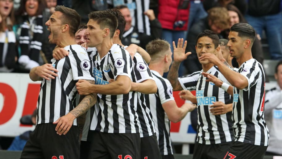 NEWCASTLE UPON TYNE, ENGLAND - AUGUST 26:  Joselu of Newcastle (L) celebrates scoring his team's first goal during the Premier League match between Newcastle United and Chelsea FC at St. James Park on August 26, 2018 in Newcastle upon Tyne, United Kingdom. (Photo by Ian Horrocks/Getty Images)