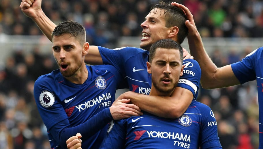 NEWCASTLE UPON TYNE, ENGLAND - AUGUST 26:  Eden Hazard of Chelsea celebrates with teammates after scoring a penalty for his team's first goal during the Premier League match between Newcastle United and Chelsea FC at St. James Park on August 26, 2018 in Newcastle upon Tyne, United Kingdom.  (Photo by Stu Forster/Getty Images)