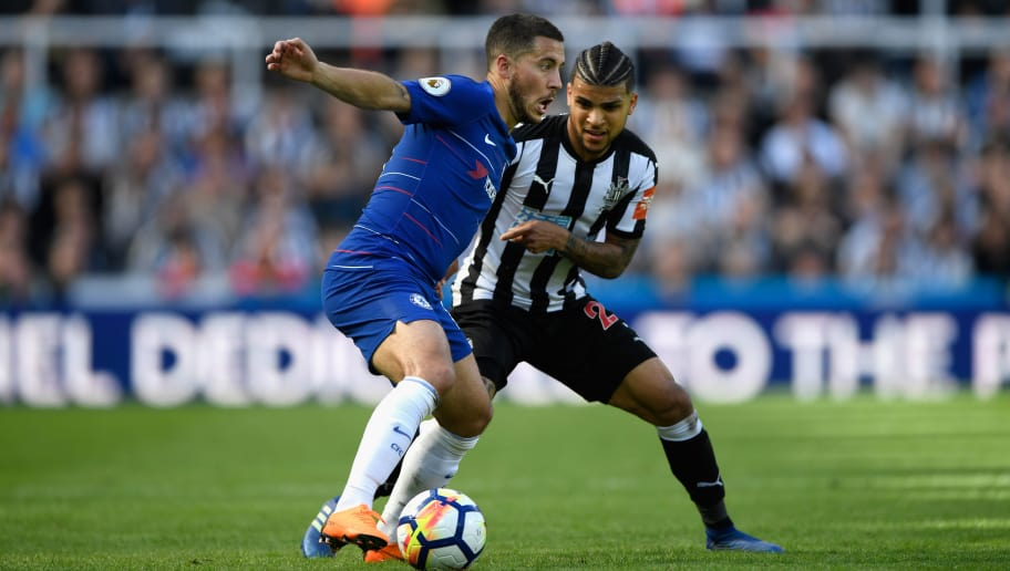NEWCASTLE UPON TYNE, ENGLAND - MAY 13:  Chelsea player Eden Hazard holds off the challenge od DeAndre Yedlin of Newcastle  during the Premier League match between Newcastle United and Chelsea at St. James Park on May 13, 2018 in Newcastle upon Tyne, England.  (Photo by Stu Forster/Getty Images)