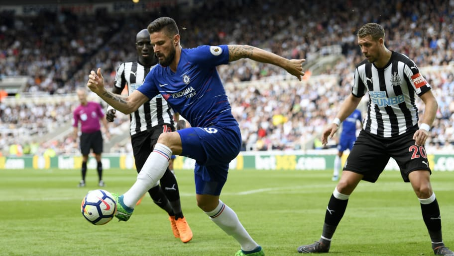 NEWCASTLE UPON TYNE, ENGLAND - MAY 13:  Olivier Giroud of Chelsea controls the ball as Florian Lejeune of Newcastle United looks on during the Premier League match between Newcastle United and Chelsea at St. James Park on May 13, 2018 in Newcastle upon Tyne, England.  (Photo by Stu Forster/Getty Images)