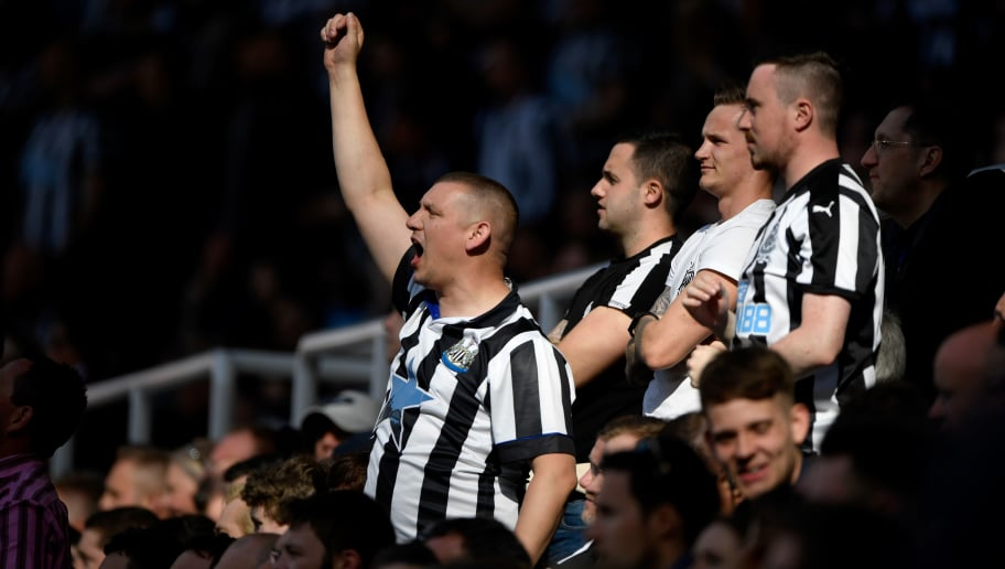 NEWCASTLE UPON TYNE, ENGLAND - MAY 13: Newcastle fans celebrate the third goal during the Premier League match between Newcastle United and Chelsea at St. James Park on May 13, 2018 in Newcastle upon Tyne, England.  (Photo by Stu Forster/Getty Images)