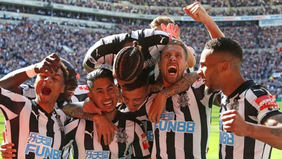 NEWCASTLE UPON TYNE, ENGLAND - MAY 13: Newcastle players celebrate the third goal scored by Ayoze Perez during the Premier League match between Newcastle United and Chelsea at St. James Park on May 13, 2018 in Newcastle upon Tyne, England. (Photo by Ian Horrocks/Getty Images)