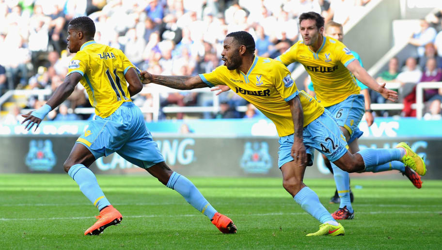 NEWCASTLE UPON TYNE, ENGLAND - AUGUST 30:  Wilfried Zaha of Crystal Palace celebrates scoring third goal with Jason Puncheon during the Barclays Premier League match between Newcastle United and Crystal Palace at St James' Park on August 30, 2014 in Newcastle upon Tyne, England.  (Photo by Tony Marshall/Getty Images)