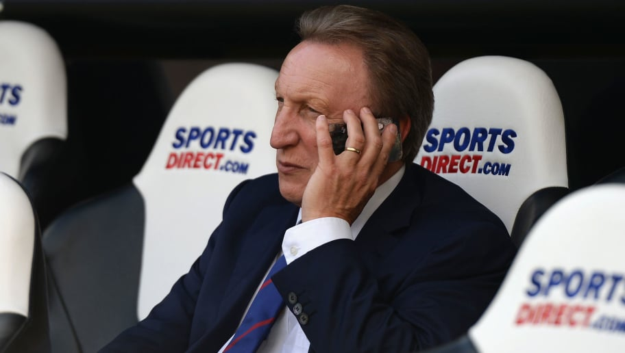 NEWCASTLE UPON TYNE, ENGLAND - AUGUST 30:  Manager Neil Warnock of Crystal Palace talks on the phone in the dug out prior to the Barclays Premier League match between Newcastle United and Crystal Palace at St James' Park on August 30, 2014 in Newcastle upon Tyne, England.  (Photo by Nigel Roddis/Getty Images)