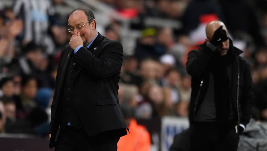 NEWCASTLE UPON TYNE, ENGLAND - DECEMBER 27:  Newcastle manager Rafa Benitez (l) and Pep Guardiola react  during the Premier League match between Newcastle United and Manchester City at St James' Park on December 27, 2017 in Newcastle Upon Tyne, England.  (Photo by Stu Forster/Getty Images)
