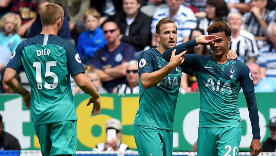 NEWCASTLE UPON TYNE, ENGLAND - AUGUST 11:  Dele Alli of Tottenham Hotspur celebrates with teammate Harry Kane after scoring his team's second goal during the Premier League match between Newcastle United and Tottenham Hotspur at St. James Park on August 11, 2018 in Newcastle upon Tyne, United Kingdom.  (Photo by Tony Marshall/Getty Images)