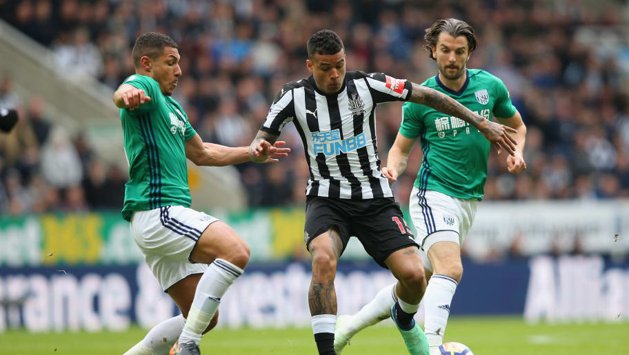 NEWCASTLE UPON TYNE, ENGLAND - APRIL 28:  Kenedy of Newcastle United is challenged by Jake Livermore of West Bromwich Albion and Jay Rodriguez of West Bromwich Albion during the Premier League match between Newcastle United and West Bromwich Albion at St. James Park on April 28, 2018 in Newcastle upon Tyne, England.  (Photo by Alex Livesey/Getty Images)