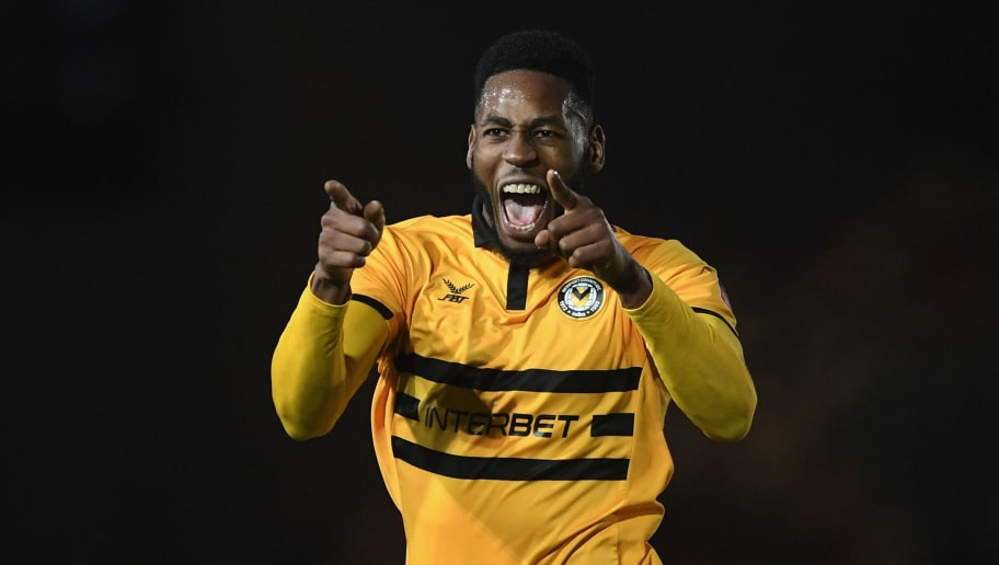 NEWPORT, WALES - DECEMBER 11: Jamille Matt of Newport County celebrates after scoring his sides second goal during The Emirates FA Cup Second Round Replay match between Newport County and Wrexham at Rodney Parade on December 11, 2018 in Newport, Wales. (Photo by Harry Trump/Getty Images)
