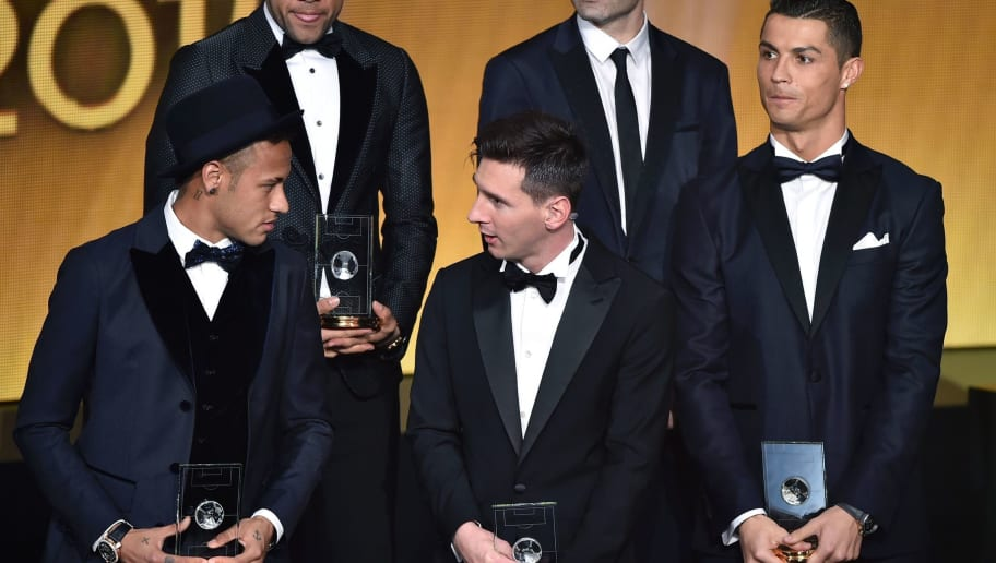 (From L) Brazil and FC Barcelona forward Neymar, Brazil and FC Barcelona defender Dani Alves, Argentina and FC Barcelona forward Lionel Messi, and Portugal and Real Madrid forward Cristiano Ronaldo pose on stage after being selected in the 2015 FIFA FIFPro World XI during the 2015 FIFA Ballon d'Or award ceremony at the Kongresshaus in Zurich on January 11, 2016. AFP PHOTO FABRICE COFFRINI / AFP / FABRICE COFFRINI        (Photo credit should read FABRICE COFFRINI/AFP/Getty Images)