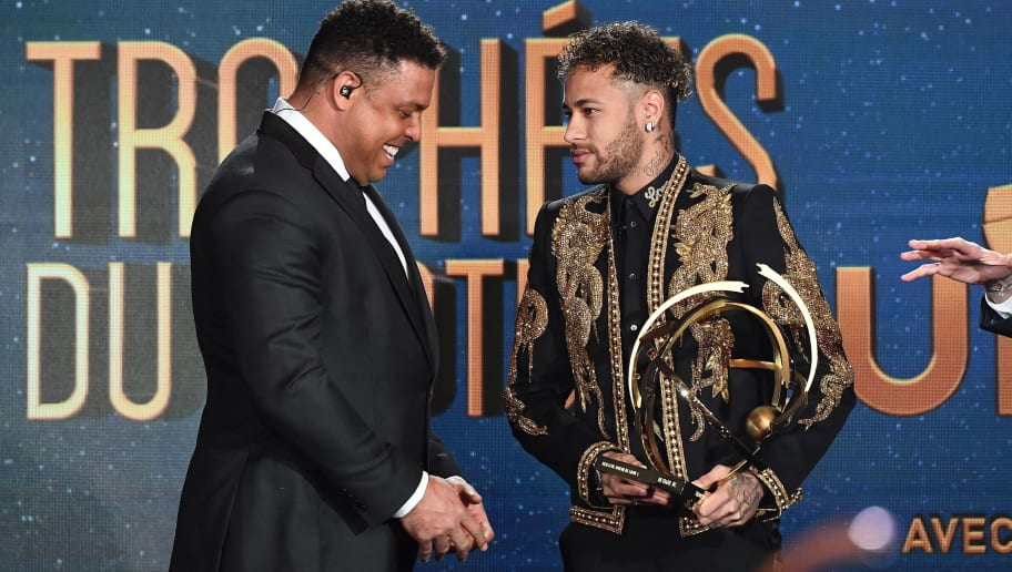 TOPSHOT - Paris Saint-Germain's Brazilian forward Neymar (R) receives the Best Ligue 1 Player award from former Brazilian international player Ronaldo during a TV show on May 13, 2018 in Paris, as part of the 27th edition of the UNFP (French National Professional Football players Union) trophy ceremony. (Photo by FRANCK FIFE / AFP)        (Photo credit should read FRANCK FIFE/AFP/Getty Images)