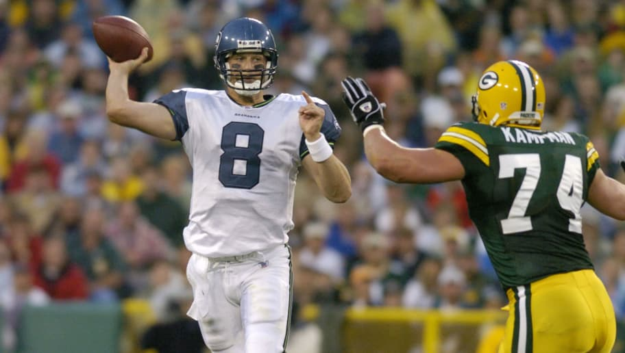 Seattle Seahawks quarterback Matt Hasselbeck sets to pass against the Green Bay Packers  at Lambeau Field August 16, 2004.  (Photo by Al Messerschmidt/Getty Images)