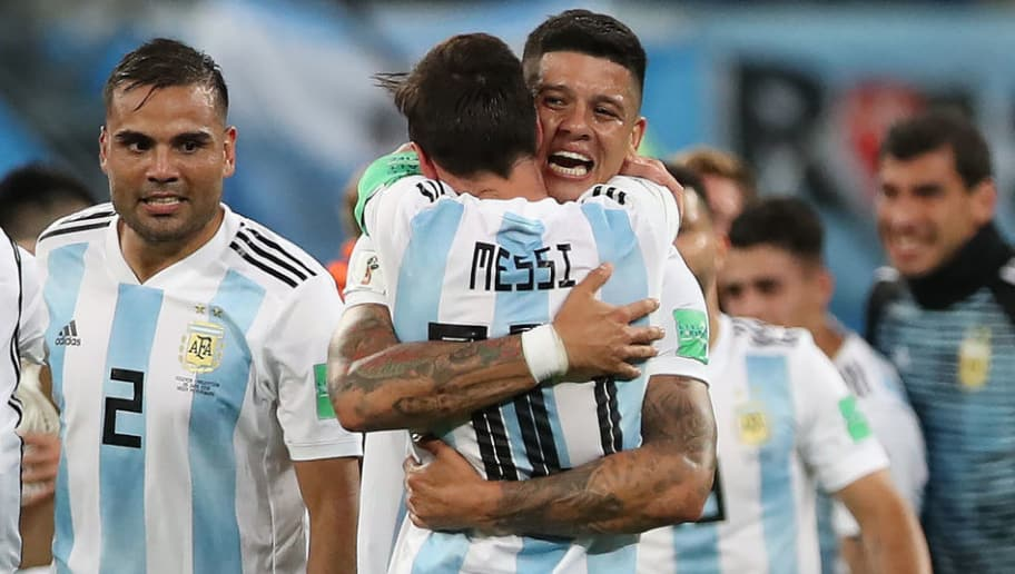 SAINT PETERSBURG, RUSSIA - JUNE 26: Marcos Rojo of Argentina celebrates at full time with Lionel Messi during the 2018 FIFA World Cup Russia group D match between Nigeria and Argentina at Saint Petersburg Stadium on June 26, 2018 in Saint Petersburg, Russia. (Photo by Ian MacNicol/Getty Images)