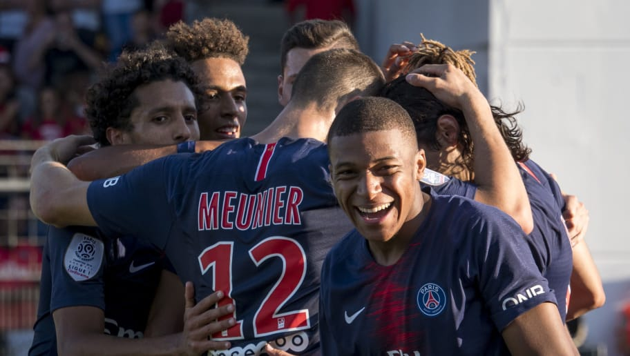 NIMES, FRANCE - SEPTEMBER 01:Kylian Mbappé of Paris Saint-Germain react after Edinson Cavani  goal during the Ligue 1 match between Paris Saint-Germain and Nimes Olympique at Stade des Costières  on September 01, 2018 in Nimes, France. (Photo by Arnold Jerocki/Getty Images)