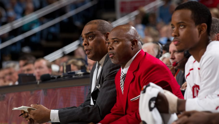 CHAPEL HILL, NC - JANUARY 29: Assistant coach Larry Harris and head coach Sidney Lowe (red blazer) of the North Carolina State Wolfpack watch their team while playing the North Carolina Tar Heels on January 29, 2011 at the Dean E. Smith Center in Chapel Hill, North Carolina. North Carolina won 84-64. (Photo by Peyton Williams/UNC/Getty Images)