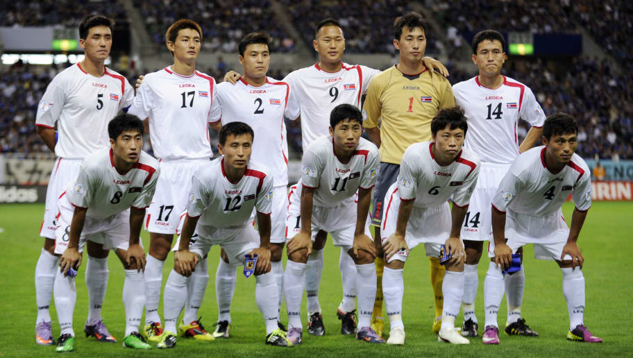 North Korean football team players pose