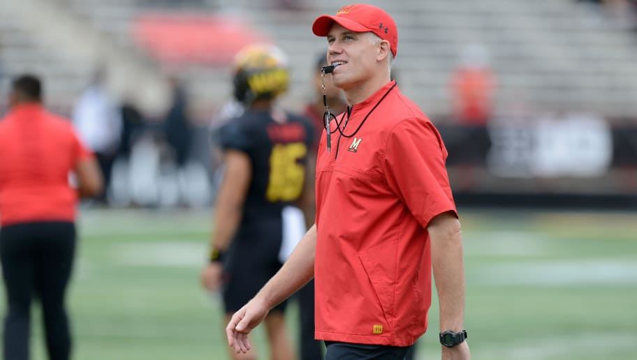 COLLEGE PARK, MD - OCTOBER 14:  Head Coach DJ Durkin of the Maryland Terrapins watches the teams warm up before the game against the Northwestern Wildcats on October 14, 2017 in College Park, Maryland.  (Photo by G Fiume/Maryland Terrapins/Getty Images)