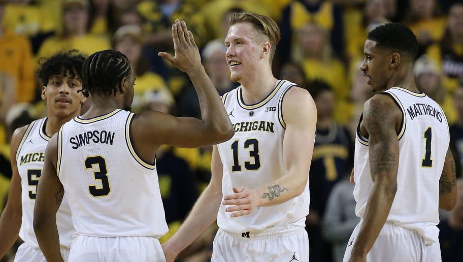 Iowa michigan basketball betting line spread betting tax sole income earner