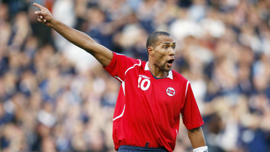 Norway's John Carew reacts to the refere