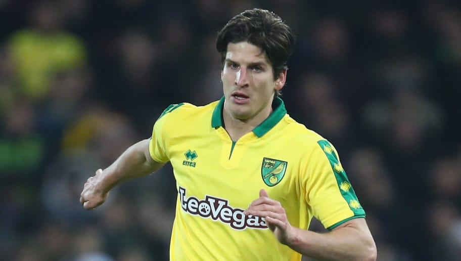NORWICH, ENGLAND - JANUARY 06: Timm Klose of Norwich City runs with the ball during the The Emirates FA Cup Third Round match between Norwich City and Chelsea at Carrow Road on January 6, 2018 in Norwich, England.  (Photo by James Chance/Getty Images)