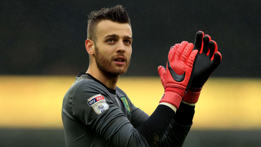 NORWICH, ENGLAND - APRIL 28:  Angus Gunn of Norwich City leaves the field following victory during the Sky Bet Championship match between Norwich City and Leeds United at Carrow Road on April 28, 2018 in Norwich, England. (Photo by Stephen Pond/Getty Images)