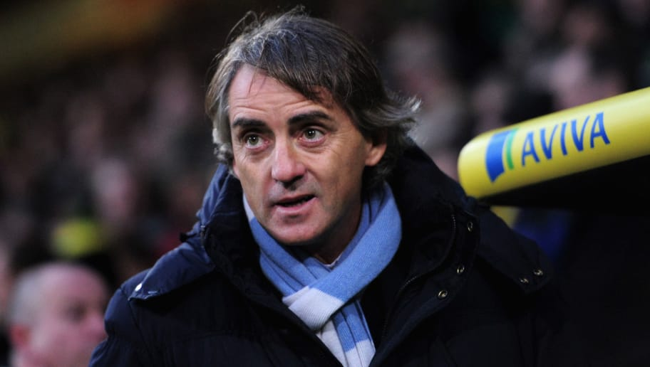 NORWICH, ENGLAND - DECEMBER 29:  Manchester City manager Roberto Mancini looks on ahead of the Barclays Premier League match between Norwich City and Manchester City at Carrow Road on December 29, 2012 in Norwich, England.  (Photo by Jamie McDonald/Getty Images)