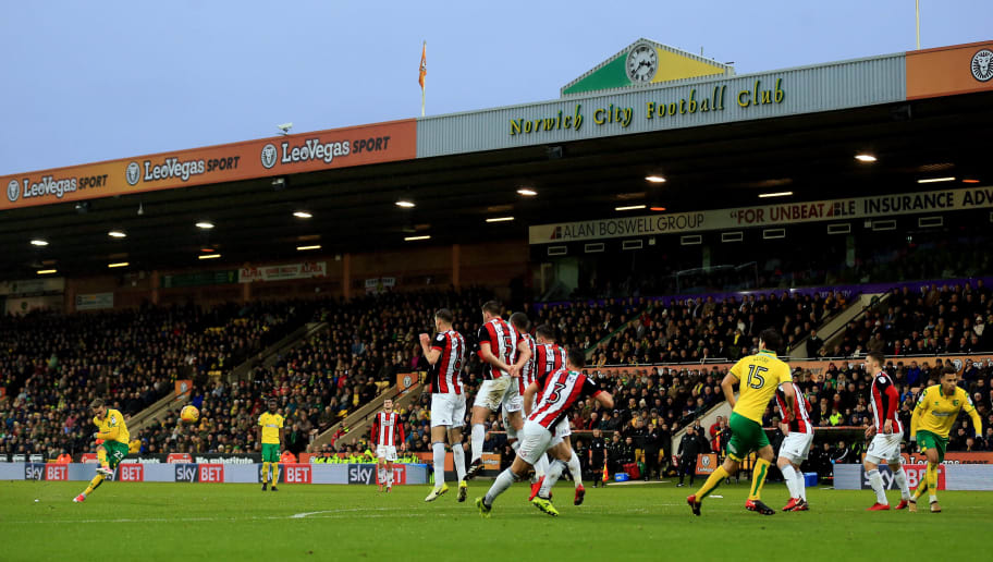 NORWICH, ENGLAND - JANUARY 20:  James Maddison of Norwich City strikes a free kick during the Sky Bet Championship match between Norwich City and Sheffield United at Carrow Road on January 20, 2018 in Norwich, England. (Photo by Stephen Pond/Getty Images)