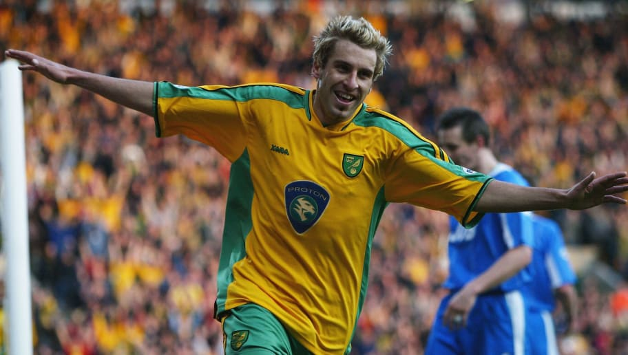 NORWICH, ENGLAND - APRIL 9:  Darren Huckerby of Norwich celebrates after scoring during the Nationside Division One match between Norwich City and Wigan Athletic at Carrow Road on April 9, 2004 in Norwich, England.  (Photo by Jamie McDonald/Getty Images)